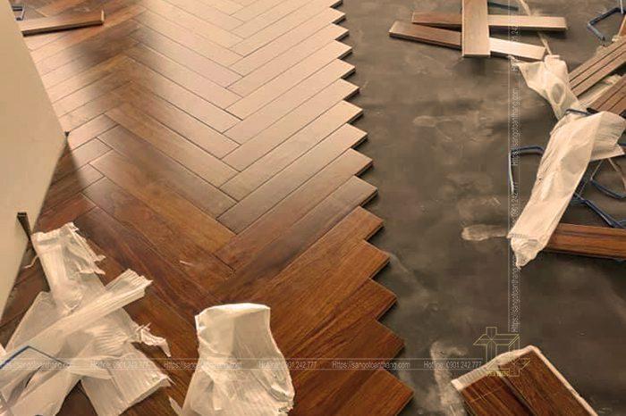 Sàn gỗ Căm xe xương cá tạo sự đồng điệu trong không gian mở của căn nhà