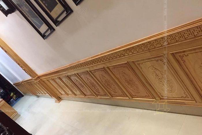 Không gian chủ yếu để ốp tường gỗ gõ đỏ là ở phòng khách